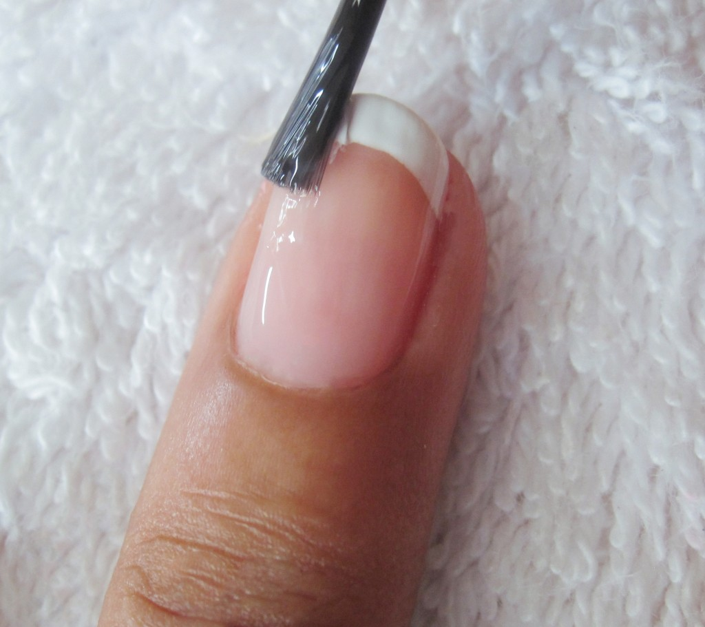 Brush transparent pink, cream or clear polish and allow to dry. Allow to dry completely and apply top coat to protect your nails and seal in the colour. Allow to dry.