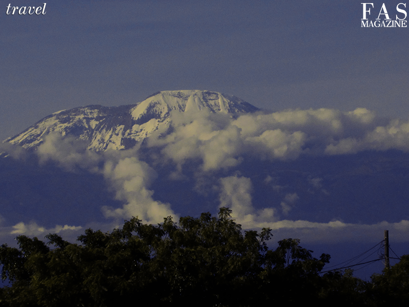 Mount Kilimanjaro as viewed at sunset somewhere between Moshi and Arusha, Tanzania. Photographed by Shellina Ebrahim.
