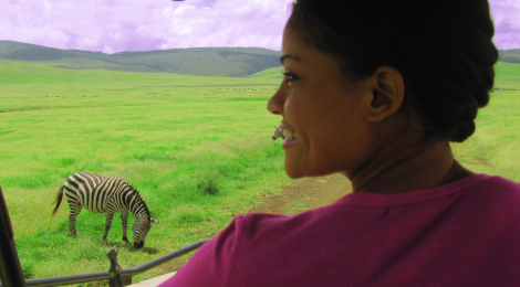 Shellina and a Zebra at The Ngorongoro Crater Park, Tanzania. Photographed by Shellina Ebrahim
