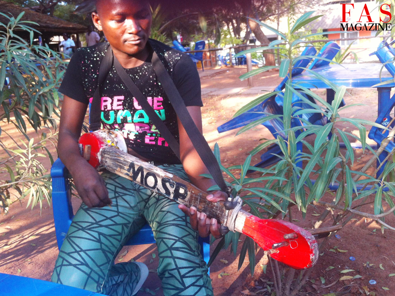 Mosp playing a hand crafted Banjo in Dar-es-salaam.