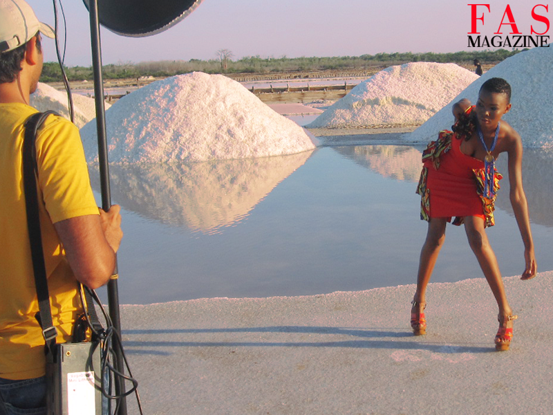 Miss Universe Tanzania 2013 Betty Boniface on set shooting with crew by the salt farms at Saadani National Park, Tanzania.