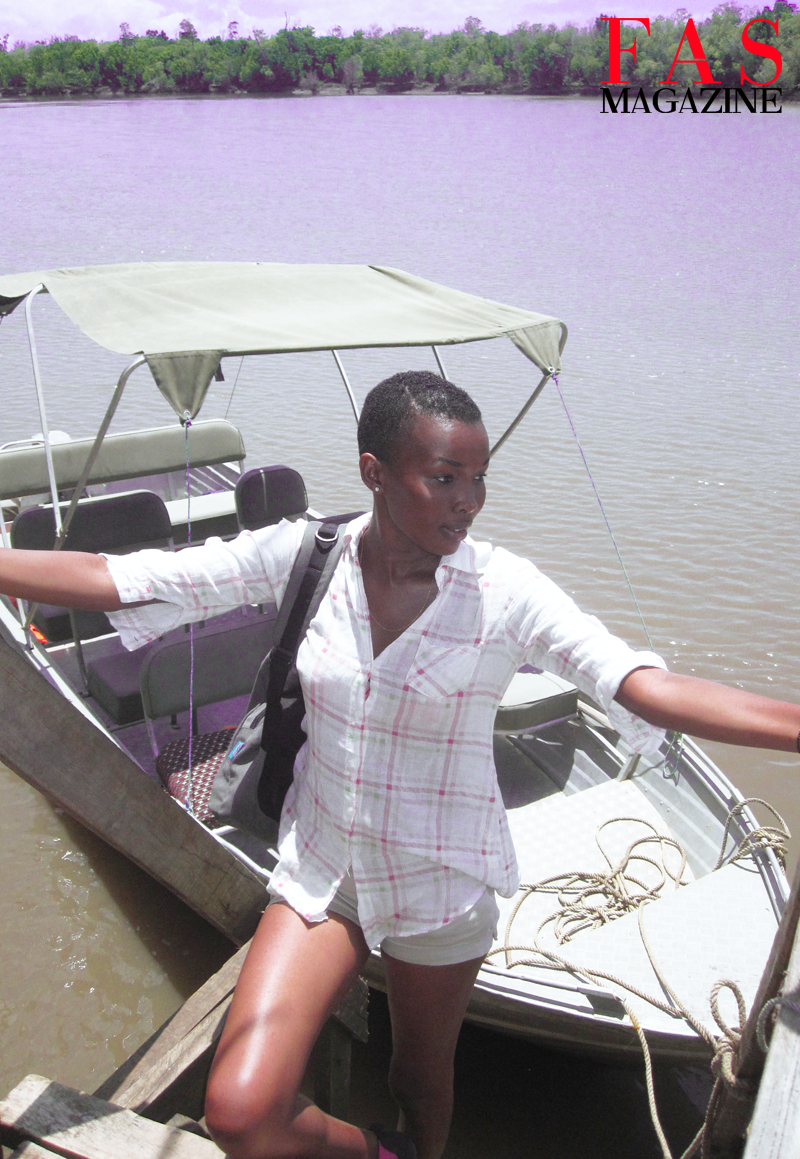 Miss Universe Tanzania 2013 Betty Boniface by a river inhabited by crocodiles at Saadani National Park.