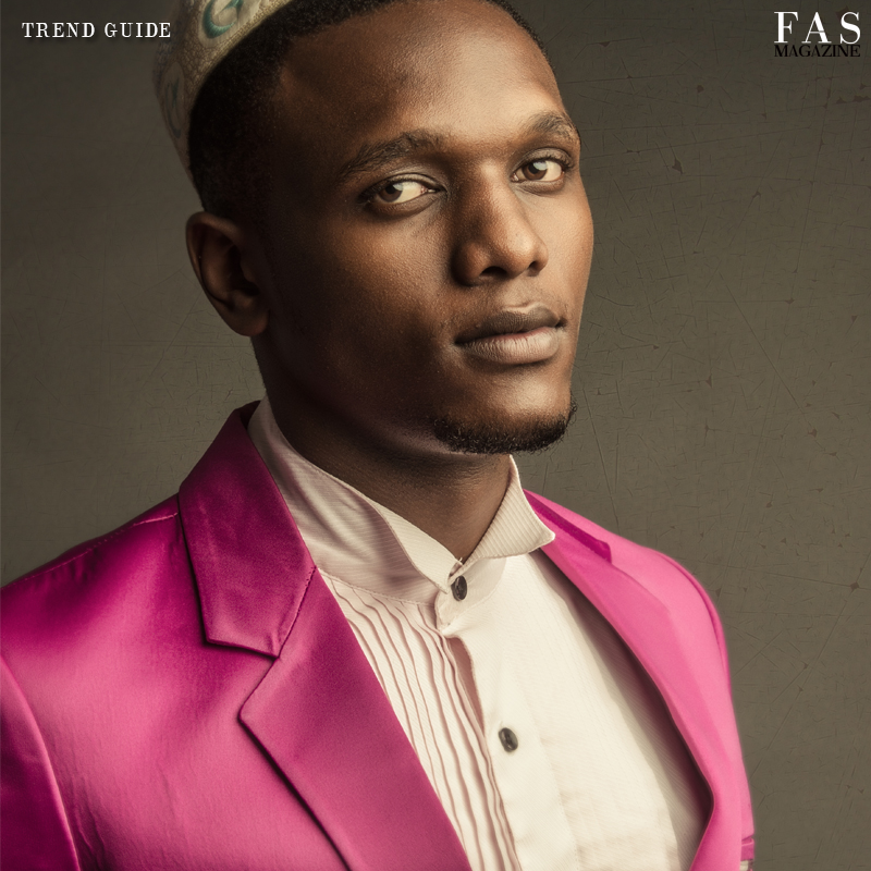 Man in Pink Fas Magazine fashion editorial with model Lota Mollel, Photographer Azh, Stylist and Art Director Shellina Ebrahim. Pink blazer designed by Martin Kadinda.